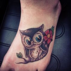 Cute Blue Eyed Owl And Flower Tattoos On Foot