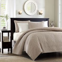 I want something like this but it might be too stiff.. I want something comfortable!... Madison Park Quebec Coverlet Set in Khaki from Bed Bath & Beyond