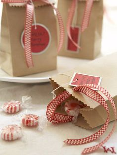 "Small brown Candy Bags chock full of peppermints and dressed with spunky ribbons are thoughtful give-away gifts. Include tags emblazoned with the words God Jul (""Merry Christmas"" in Swedish)."