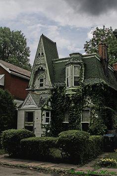 Garden Walk homes by broken gargoyle, via Flickr