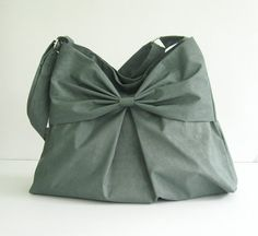 Hey, I found this really awesome Etsy listing at https://www.etsy.com/listing/73045806/sale-grey-water-resistant-bag-nylon-bow