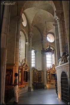 FRENCH ROMANESQUE: View of the AMBULATORY, Basilica of St. Sernin, Toulouse, France. One of the most famous pilgrimage churches of the period, pilgrims would have entered the church through the transept and navigated through the ambulatory to visit the reliquaries displayed there.