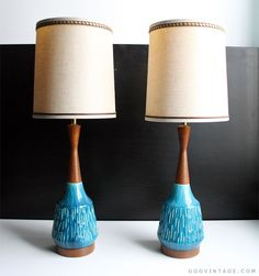PAIR OF MID CENTURY MODERN BLUE WITH GREEN TONES GLAZED CERAMIC AND TEAK TABLE LAMPS - SOLD