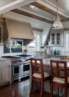 Kitchen. Beautiful kitchen design. This kitchen is great because it's not too big and it feels incredibly welcoming.  The cabinet's were selected by the owner and built by Rosbeck Builders cabinet maker. The finish was a grain painted cabinets.. #Kitchen #KitchenIdeas #SmallKitchen
