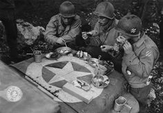 Christmas dinner on the hood of a jeep in Italy 1943. Soldier on the right belongs to 3rd Infantry Division while two others served in 163rd Signal Company.