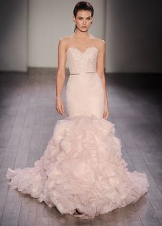 Blush textured fit to flare bridal gown, strapless sweetheart neckline, beaded Chantilly lace elongated bodice with thin satin ribbon at natural waist, ruffled organza skirt, chapel train. Also available in Ivory. Lazaro Style 3612