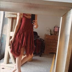 Free People Dress Never worn. Perfect condition. Reddish color. Double straps. Bohemian feel. XS but this dress tends to run large so it'll fit a size small. My measurements are 34-28-38 for reference. Free People Dresses