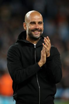 Josep Guardiola, Manager of Manchester City looks on after the Premier League match between Manchester City and Brighton and Hove Albion at Etihad Stadium on May 2018 in Manchester, England. Get premium, high resolution news photos at Getty Images Bald Men With Beards, Bald With Beard, Bald Man, Manchester United Team, Manchester England, Brighton & Hove Albion, Brighton And Hove, Pep Guardiola Style, Manchester City Wallpaper