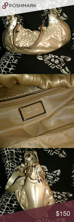 Cromia Italian handbag Beautiful workmanship  Quality leather, gold color Zipper pocket inside and two slip pockets and also a divider zipper pocket  15 inches wide and 6 inches in length  2 inches depth 16 inches handle  Fits shoulder very comfortably!! Cromia Italian Bags Shoulder Bags