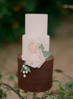 Photo by Carmen Santorelli Photography; via Style Me Pretty (http://www.stylemepretty.com/gallery/category/cakes/picture/1448026/).  In search of cake credit.