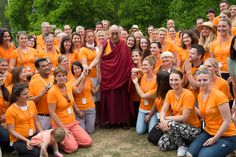 His Holiness the Dalai Lama posing for a photo with volunteers after his talk at Wiesbaden Kupark in Wiesbaden, Hessen, Germany on July 12, 2015. Photo/Manuel Bauer