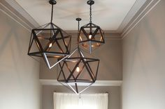 Trio of lights in a large entry space-The Fat Hydrangea: Parade of Homes 2013 - House #1