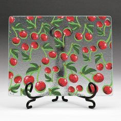 A cutting board decorated with #cherries! Cooking fun! #CookWithCherryMan www.cherryman.com