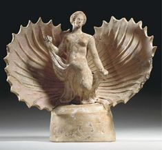 A GREEK TERRACOTTA APHRODITE HELLENISTIC PERIOD, CIRCA 3RD CENTURY B.C.