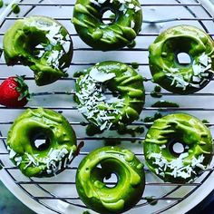 Grass green pastry with glowing green glaze, possibly radioactive. Also, the donut at 10 o'clock is about to devour that unfortunate berry.