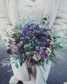 winter wedding bouquet with muted green and dusky pinks and purples. This bouquet by Jennifer Pinder contains hydrangea, sea holly (thistle), astrantia and wax flower xx