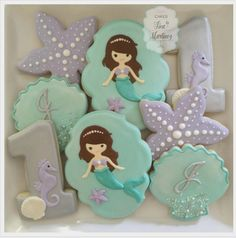 "Tina Martinez on Instagram: ""Cookies to go along with Jacquelyn's mermaid themed cakes. Happy 1st birthday! #cookies #decoratedcookies #sugarcookies #royalicingcookies…"""