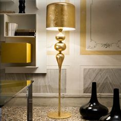 Eva Floor lamp in Gold Leaf finish by Masiero: http://www.masierogroup.com/c8_40/it/Eva%20STL3+1.ashx    Learn more about Masiero here:  http://light-ca.com/decorative_product_page.php?uid=Q1To4TSGwX&select1=&select2=&select3=&select4=