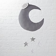 The night sky may not be visible from your little one's nursery, but this moon mobile is the next best thing. Featuring a moon and hanging metallic silver stars, it's the perfect accent for any nursery.