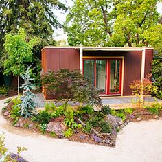 With a tiny house, you can transform a lawn into a wild-around-the-edges zone for a complete cabin-in-the-woods effect