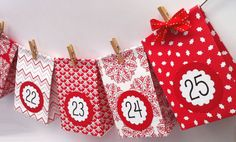 Red and White Advent Calendar. Gift bags handmade from scrapbook paper. A beautiful mini gift bag Advent Calendar garland. Numbered 1-25.
