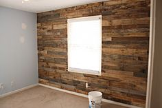 Using wood from pallets to create a barn-wood wall. (well, it looks like barn wood, but it's not. Obviously.) Would work well with some of the other ideas in here. (painting or staining certain areas of wood, wood on ceiling? Or would it be too heavy?)