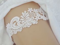 A personal favorite from my Etsy shop https://www.etsy.com/listing/254473120/keepsake-wedding-garter-venise-lace