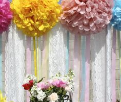 Lace and pompom backdrop at a Birdie Baby Shower #bird #babyshower
