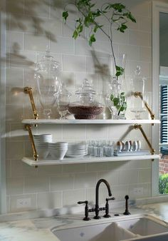 Our old Victorian house has no window over the kitchen sink… here is a collection of design ideas for alternatives to a window over the kitchen sink.