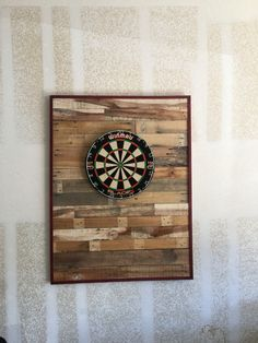 Dart board wall protector made from pellet wood