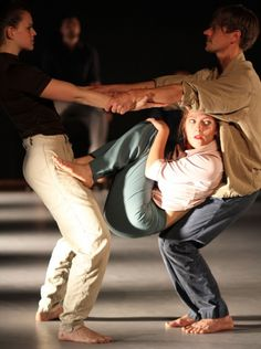 Ensemble, trust, counter-balance, focus AND the ability to tell a story. Perfect photo of physical theatre at work.