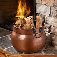 Log Bucket - I like this one.  Dogs could still get at the logs, but definitely more challenging than floor height fully exposed wood.  I also think this copper color would help break up all the blues and slates the room has now.