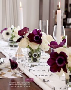 I love everything about this: the graphic linens, the purple and white anemones, the vases...it's so subtle, and still so bold.