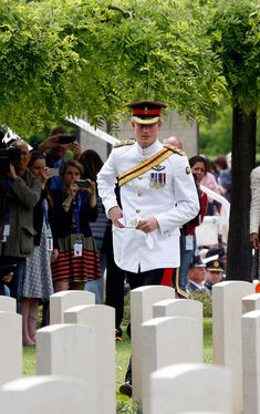 Prince Harry looks at the graves at the end of the UK commemoration at the Cassino Commonwealth War Cemetery on May 19, 2014