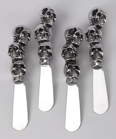 Sweet spreads meet savory breads with the help of this hand-painted set. Three shining skulls top each stainless steel blade and can be dipped in an assortment of options from honey butter to red pepper hummus.Includes four spreaders5'' longStainless steel bladesHand wash