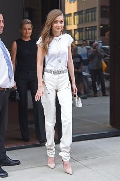 Gigi Hadid wearing Jason Stalvey Top Handle 2.0 Lizard Bag, Aquazzura Heartbreaker Pumps, Y/project Convertible Pants, Y/project Snake Y Belt, T By Alexander Wang Cap Sleeve Fitted Bodysuit and Jacquie Aiche Opal Cap Mother of Pearl 8 Moonstone Necklace