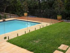 landscaping pool surrounds with glass fence - Google Search Glass Fence, Landscaping, Google Search, Outdoor Decor, Home Decor, Decoration Home, Room Decor, Yard Landscaping, Landscape Architecture