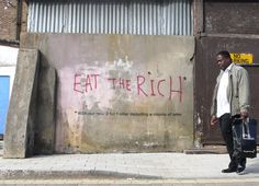 Eat the Rich (someone had sprayed Eat the Rich and Bansky added to bottom line)