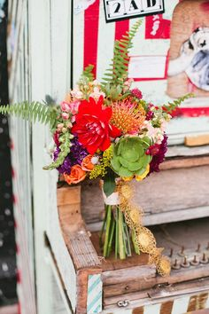 Colorful bouquet by Emerson Events. Photo by Amanda Watson Photography. #wedding #bouquet #succulent #red #orange #green #yellow #pink #purple