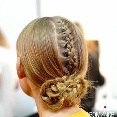 Sleek hidden braids - another fashion week style to steal