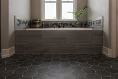 Master Bathroom Tub Surround with Tan Tile and Grey Hexagon Flooring