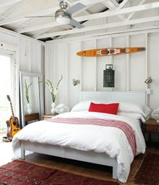 This is a great look. Water ski balances the room so well, with my fave colour combo - red & white (Oh Canada!)
