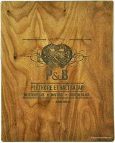 Restaurant menu covers, Plethore-et-Balthazar.  Solid walnut menus in a clipboard design decorated with laser-engraved artwork.