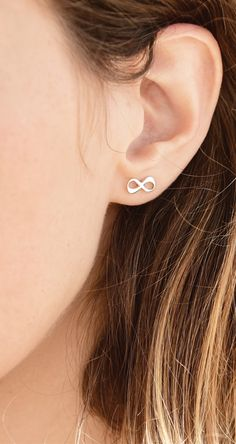 We combined two of the hottest trends - infinity jewelry and stud earrings - to give you the fabulous Infinity Stud Earrings with Initial! These infinity earrings are beautiful small studs that you can personalize, with a small initial inside one of the loops.  Looking for the perfect birthday, bridesmaids, or any other special occasion gift? These infinity symbol earrings are perfect.