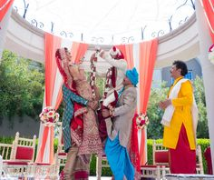 Indian bride and groom exchanging flower garlands. http://www.maharaniweddings.com/gallery/photo/83930