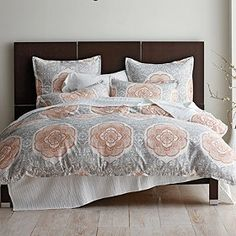 Artisan Floral Duvet Cover / Sham Shoshana, like this with the orange thin striped bedding and an orange blanket.