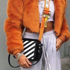 Look at these statement pieces? This is like a yolo outfit. I see I'm liking orange. Cool tubetob and she's rocking the sweats. Cool statement bag too