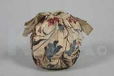 A printed cotton `Indiennes' chintz purse, circa 1780, block printed and hand coloured in gold, edged in pale blue ribbon, containing a lavender pomander, 18cm, 3in high