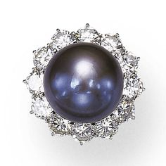 Black cultured pearl and diamond ring. Set with a button-shaped black cultured pearl measuring approximately mm, within a circular-cut diamond frame, mounted in platinum Pearl And Diamond Ring, Pearl Rings, Black Pearl Jewelry, Pearl Pendant, Cultured Pearls, Diamond Cuts, Jewelry Rings, Jewelry Design, Bling
