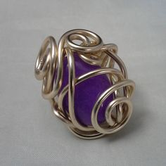 Wire wrapped Purple Jade gemstone ring.